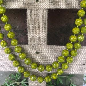 Vintage handknotted green marled Beaded Necklace